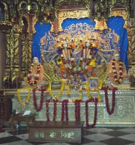One of the three altars draped with flowers